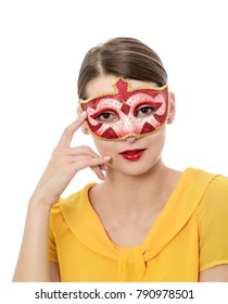 Portrait of a young woman with a Colombina Venetian mask isolated against a white background.