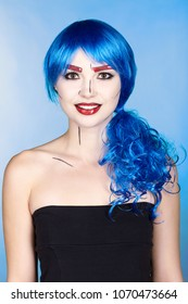 Portrait of young woman in comic  pop art make-up style.  Female in blue wig on blue background