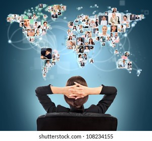 Portrait of young woman communicating with her friends across the world. Sitting against world map with photo of people. International communications concept