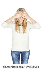 Portrait of young woman covering her eyes with her hand. human emotion expression and lifestyle concept. image on a white studio background.