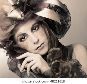 Portrait of young woman with creative make-up in doll style