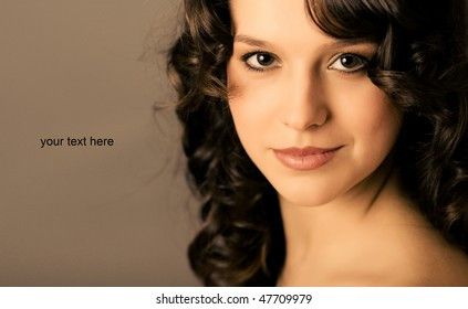 portrait of a young woman with curly hair