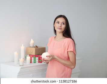 portrait of a young woman with a decorative candle .photo with copy space