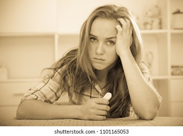 portrait of young woman in depression crying