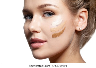 Portrait of young woman with different shades of foundation on face. Glorious brunette looking at camera with calmness and tenderness. Beauty and treatment concept