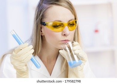 portrait of young woman doing experiment in laboratory