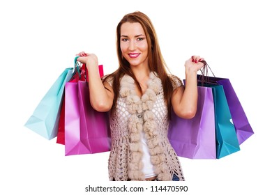 Portrait of young woman doing shopping in city