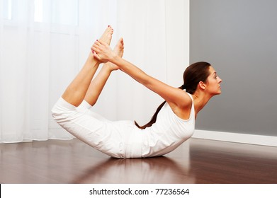 portrait of young woman doing stretch exercise