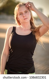 Portrait of young woman doing workout on the beach