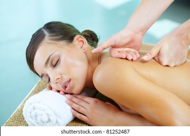 Portrait of a young woman during massage procedure