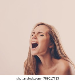 portrait of a young woman during an orgasm on a white background
