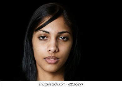 portrait of young woman of East Indian Ancestry without any makeup application