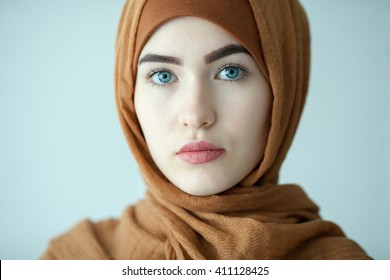 portrait of a young woman eastern type in the modern Muslim clothes and beautiful headdress