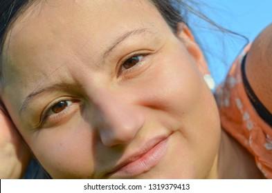 Portrait of young woman enjoying summer sunset. Summer skin care.