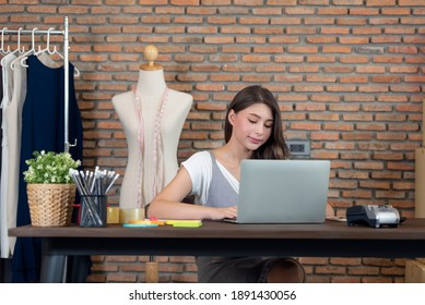 Portrait of young woman fashion designer working at her office, Startup small business entrepreneur