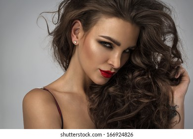 Portrait of young woman with fashion hairstyle