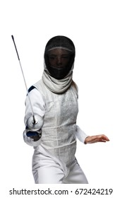 Portrait of Young woman fencer wearing mask and white fencing costume. Attacking pose. Isolated on White Background