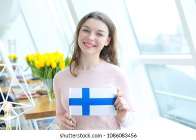 Portrait young woman with the flag of Finland.