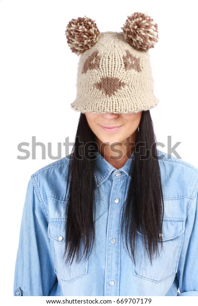 Portrait of young woman in funny hat posing on white background