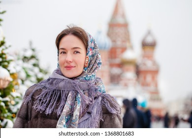 Portrait of a young woman in fur mink coat on a red square in the center of Moscow