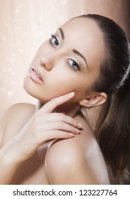 Portrait of Young Woman with Golden Makeup - Spa Concept