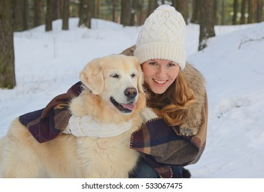 Portrait of young woman with golden retriever