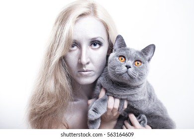 Portrait of a young woman with a gray British cat