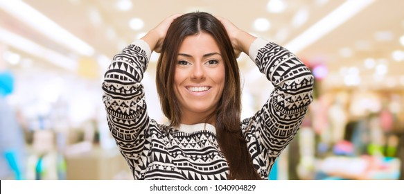 Portrait Of A Young Woman With Hand On Head at a mall