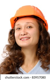 Portrait of a young woman in a hard hat isolated on white background. Construction worker or intern concept.