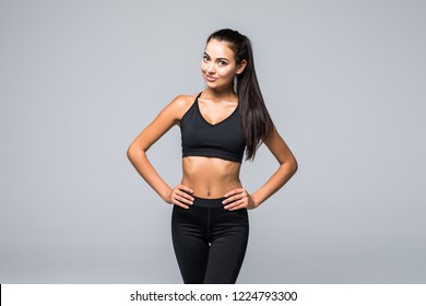 f163fcc4 Portrait of young woman with her hands on hips looking at camera. Fitness  female with