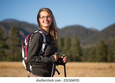 Portrait of Young Woman Hiking and Enjoying the Outdoors