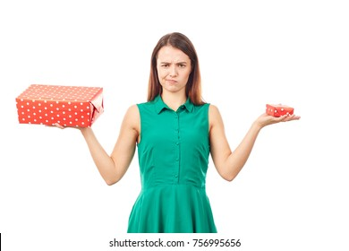 Portrait of young woman holding big gift box in one hand and small in another