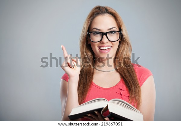 Portrait Young Woman Holding Book Pointing Stock Photo Edit