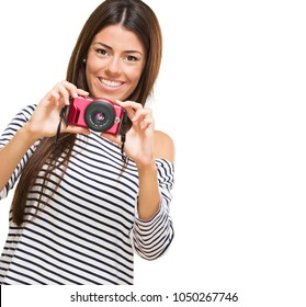 Portrait Of A Young Woman Holding Camera On White Background