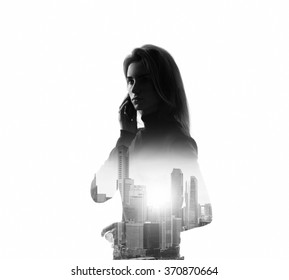 Portrait of young woman holding her smartphone in a hands. White background, isolated, bw