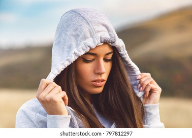 6f053ac29 Portrait of a young woman in hoodie in the nature