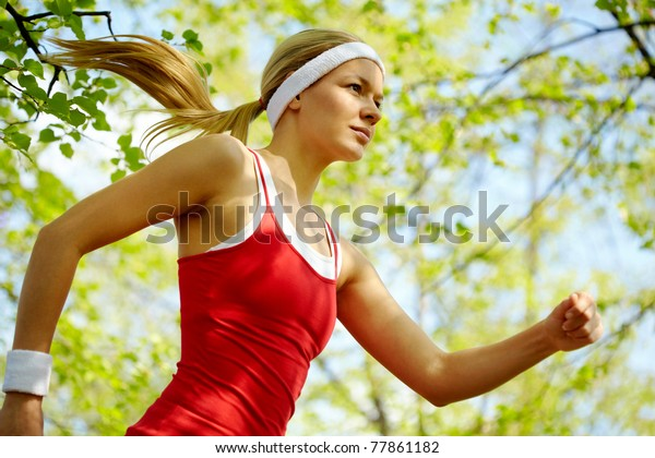 Portrait of a young woman jogging