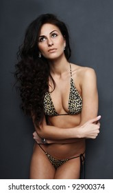 portrait of a young woman in leopard swimsuit