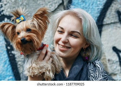 a Portrait of a young woman with a little dog