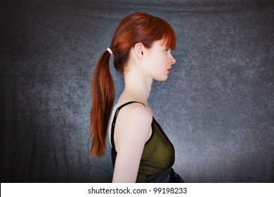 Portrait of a young woman with long red hair
