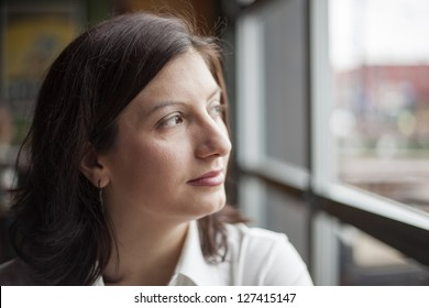 Portrait of a young woman looking away from the camera.