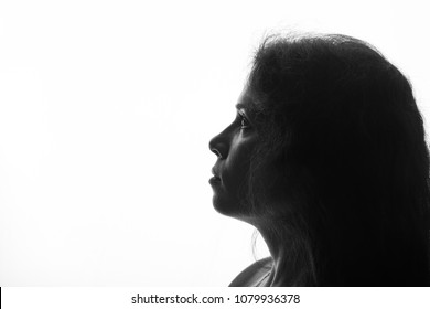 Portrait of a young woman looking up - horizontal silhouette on white background