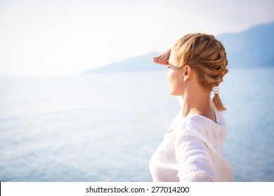 Portrait of a young woman looking over horizon
