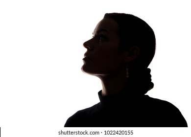 Portrait of a young woman looking up, side view - horizontal silhouette