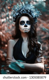 Portrait of a young woman with make-up for Halloween.