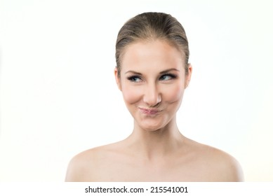 portrait of a young woman making mischievous face expression