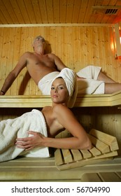 Portrait of a young woman and a man in a sauna