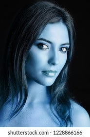Portrait of a young woman model with blue make-up.