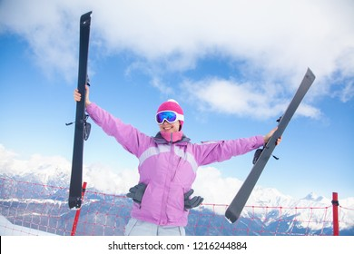 Portrait of young woman on  alpin skii in the  snow mountains
