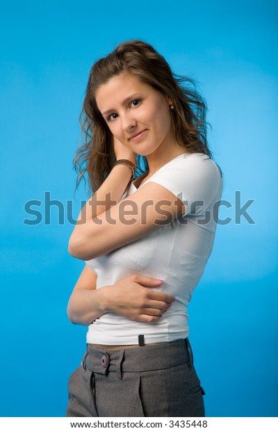 the portrait of young woman on blue background